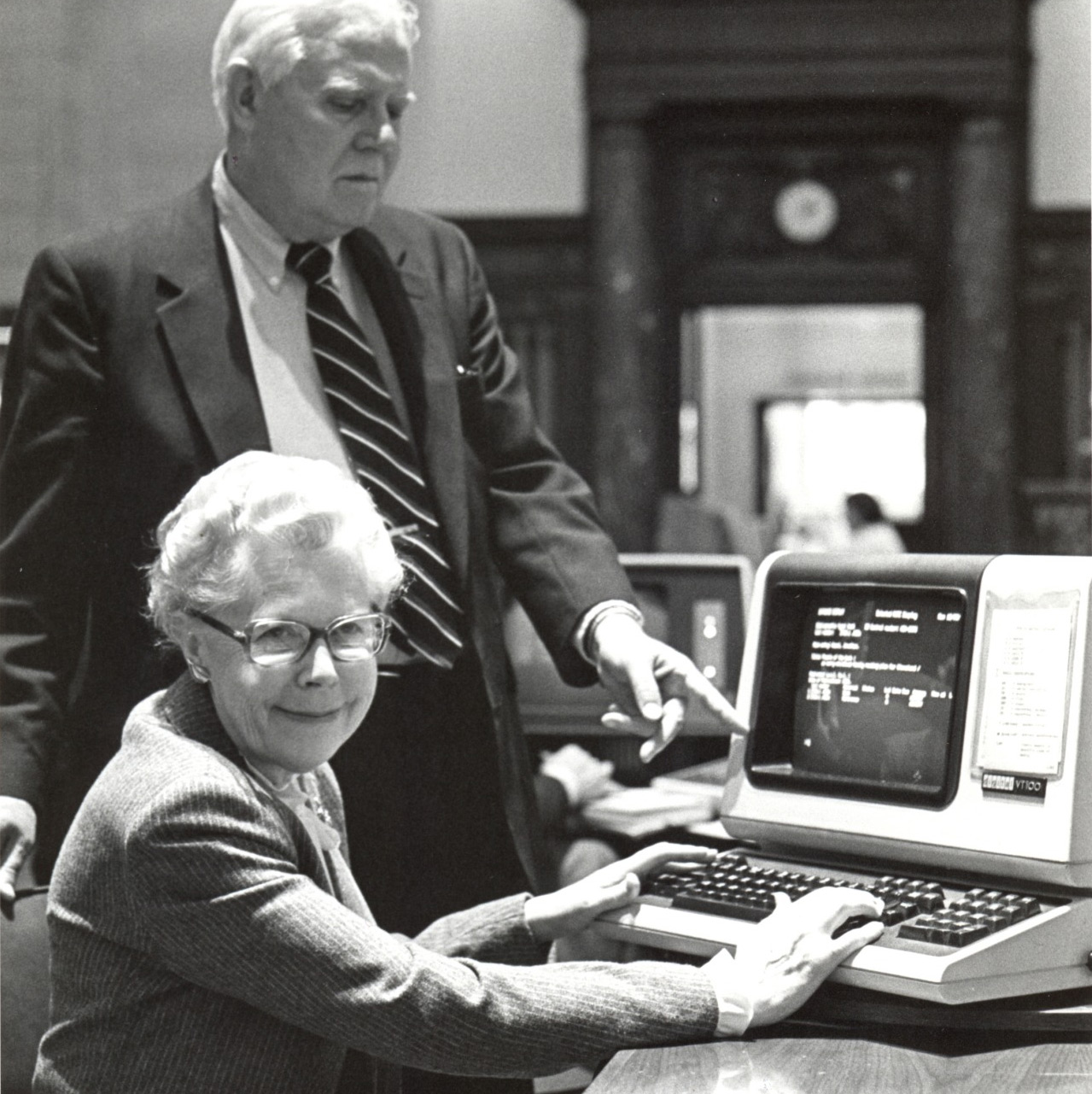 Dr. Ervin Gaines, Director and Ms. Marion Huttner, Deputy Director, using the Library's new Online Public Access Catalog, early 1980′s.