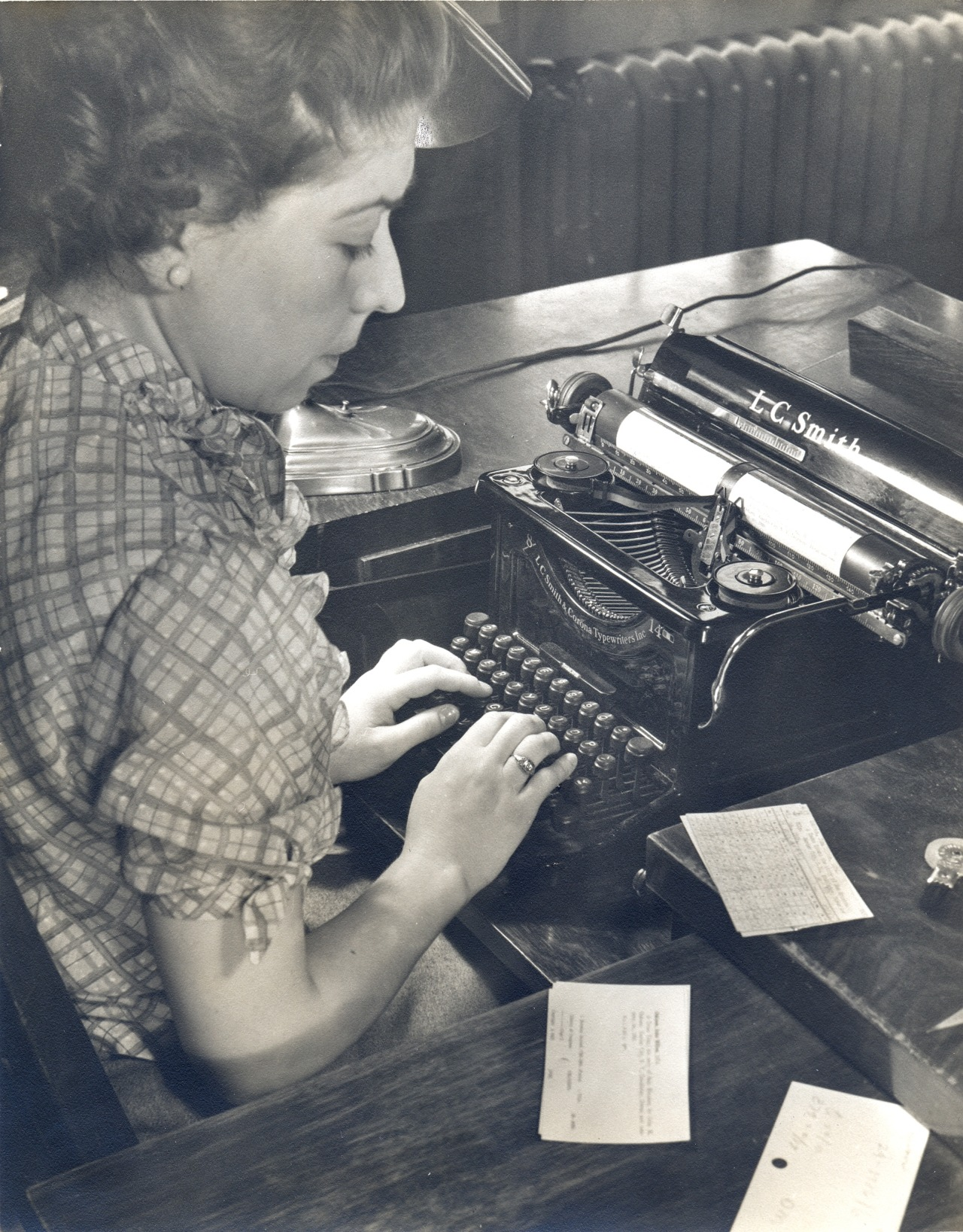 Kathleen Dowd, Catalog Department, Main Library, 1937, operating one of the Library's typewriters specially fitted to accommodate two catalog cards simultaneously.