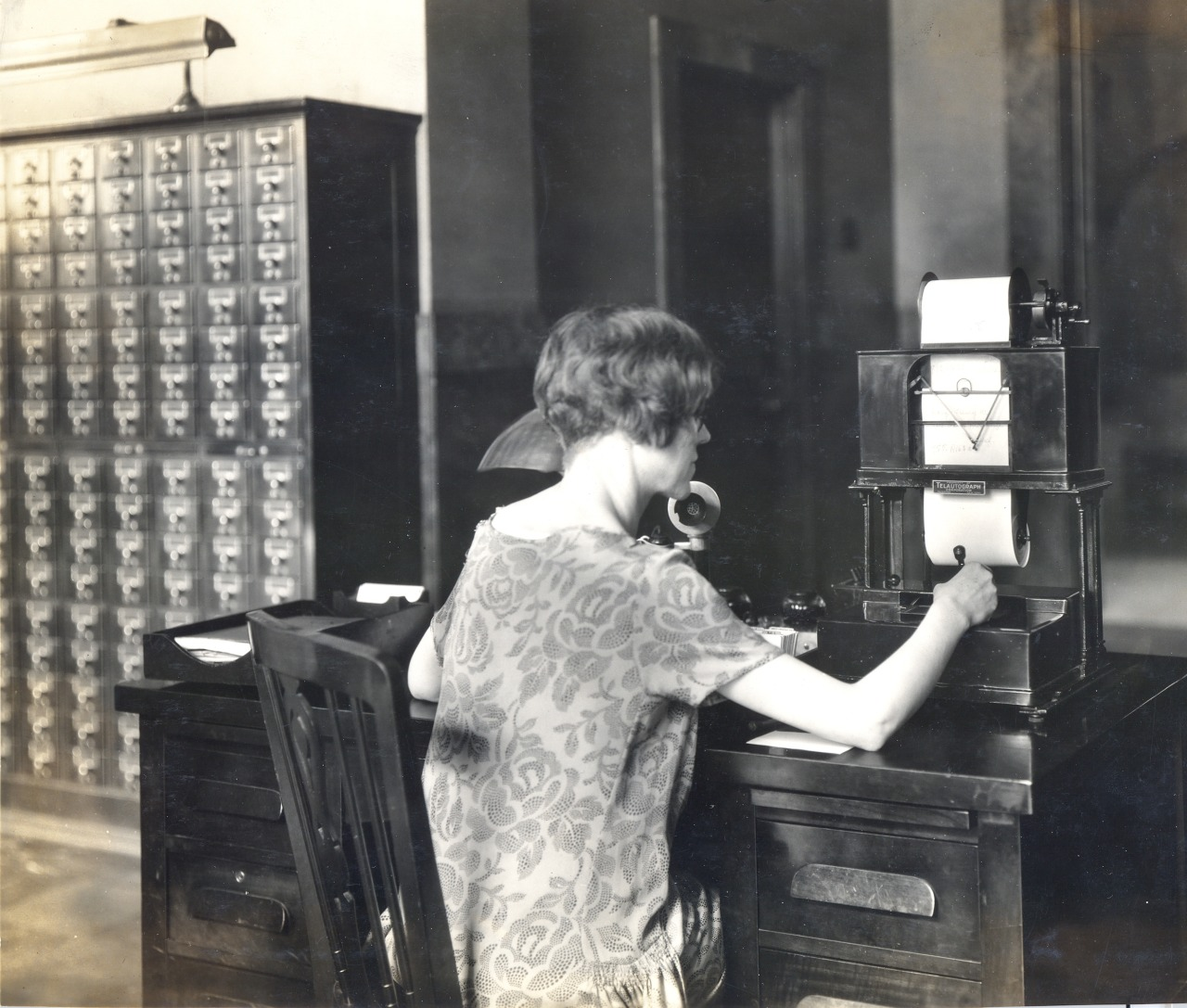 The Library's Telautograph machine was used to send information between the Public Catalog room (pictured above, ca. 1925) to various departments.