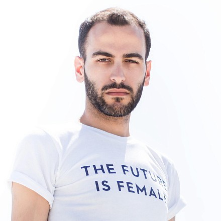 "Author in a t-shirt that reads ""The Future is Female"""