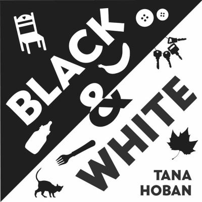 Black and White jacket cover with black and white text and simple object illustrations: a chair, a spoon, a cat.