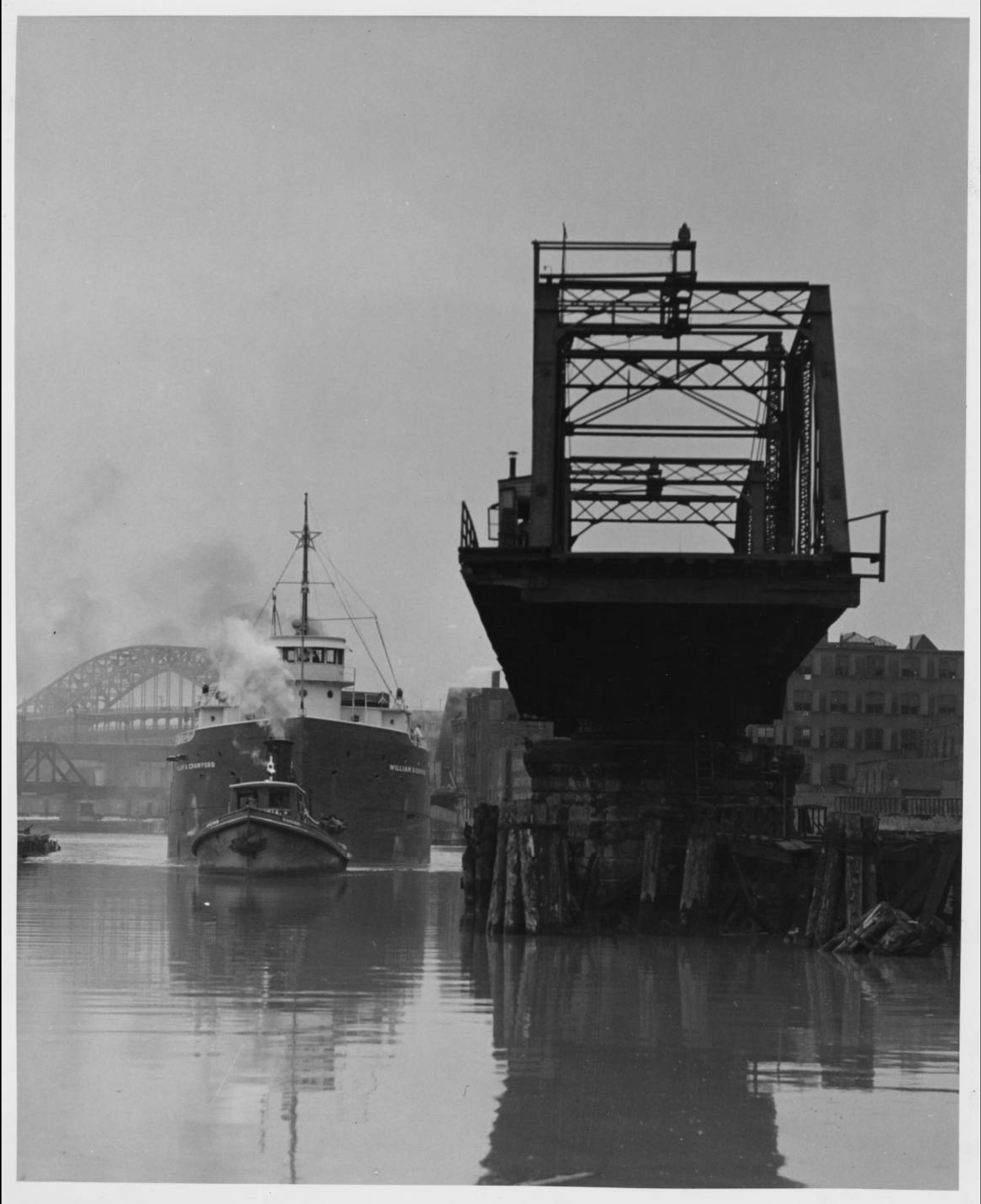 Black and white photograph of a swing bridge in the open position.