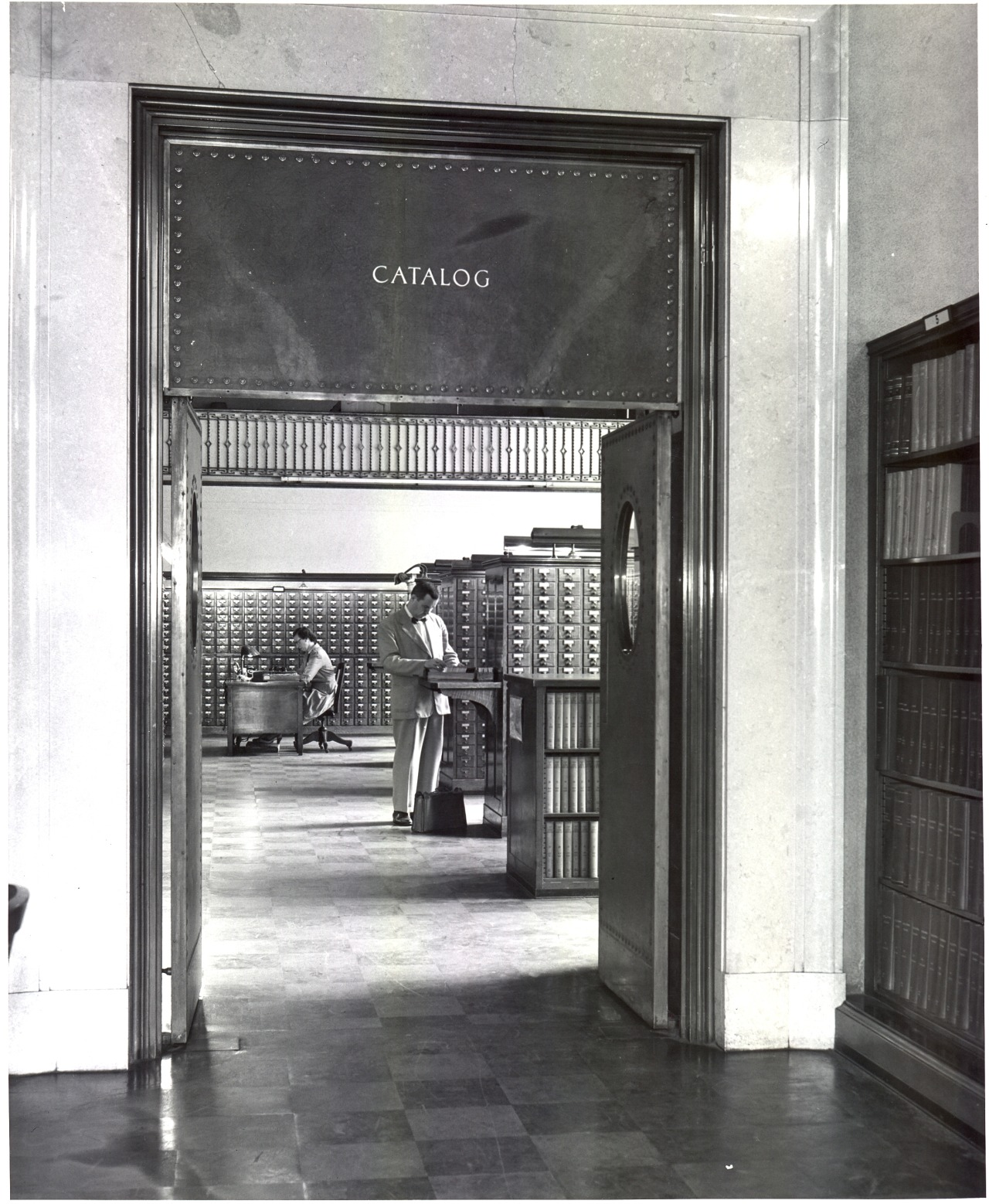 Black and white photograph of the Public Catalog room, located just inside the front entrance to the Main Library. Photo taken in 1955.