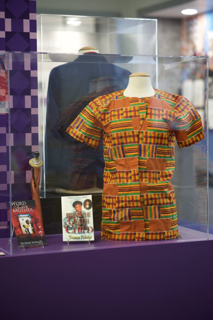 exhibit case with shirt with intricate pattern design