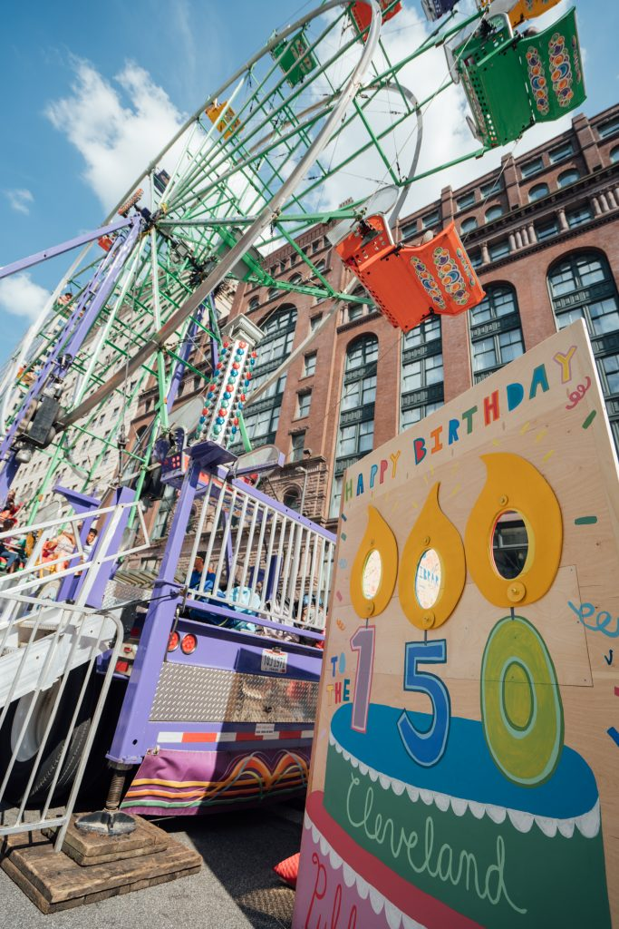 Life-size 150th birthday card in front of the Ferris wheel at the CPL 150 Street Festival