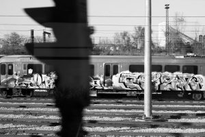 Picture of a light rail train while graffiti tags