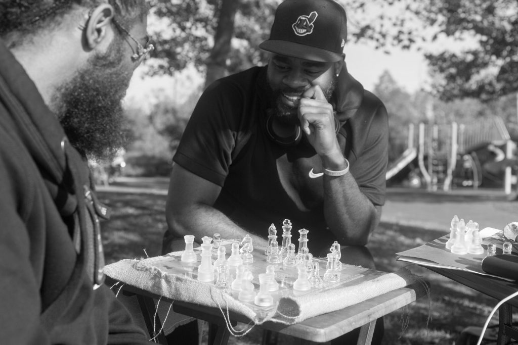 Two men in park playing chess