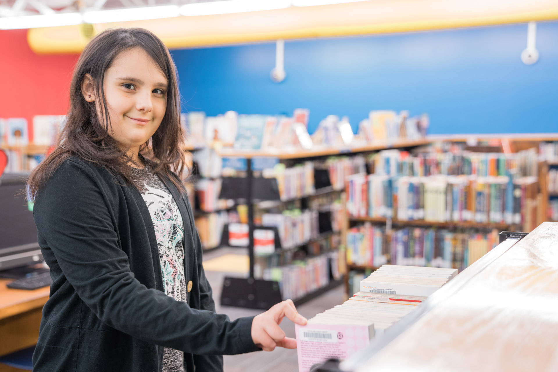 picture of young girl at a bookshelf