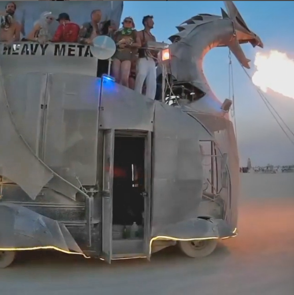 Heavy Meta - A metal fire breathing dragon that is a bus people can ride on top of.