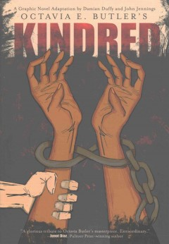 Kindred: A Graphic Novel Adaptation by Octavia Butler, adapted by Damian Duffy (jacket cover) Drawing of two brown hands with the wrist being held by a pink hand. The darker-skinned wrists are shacked.