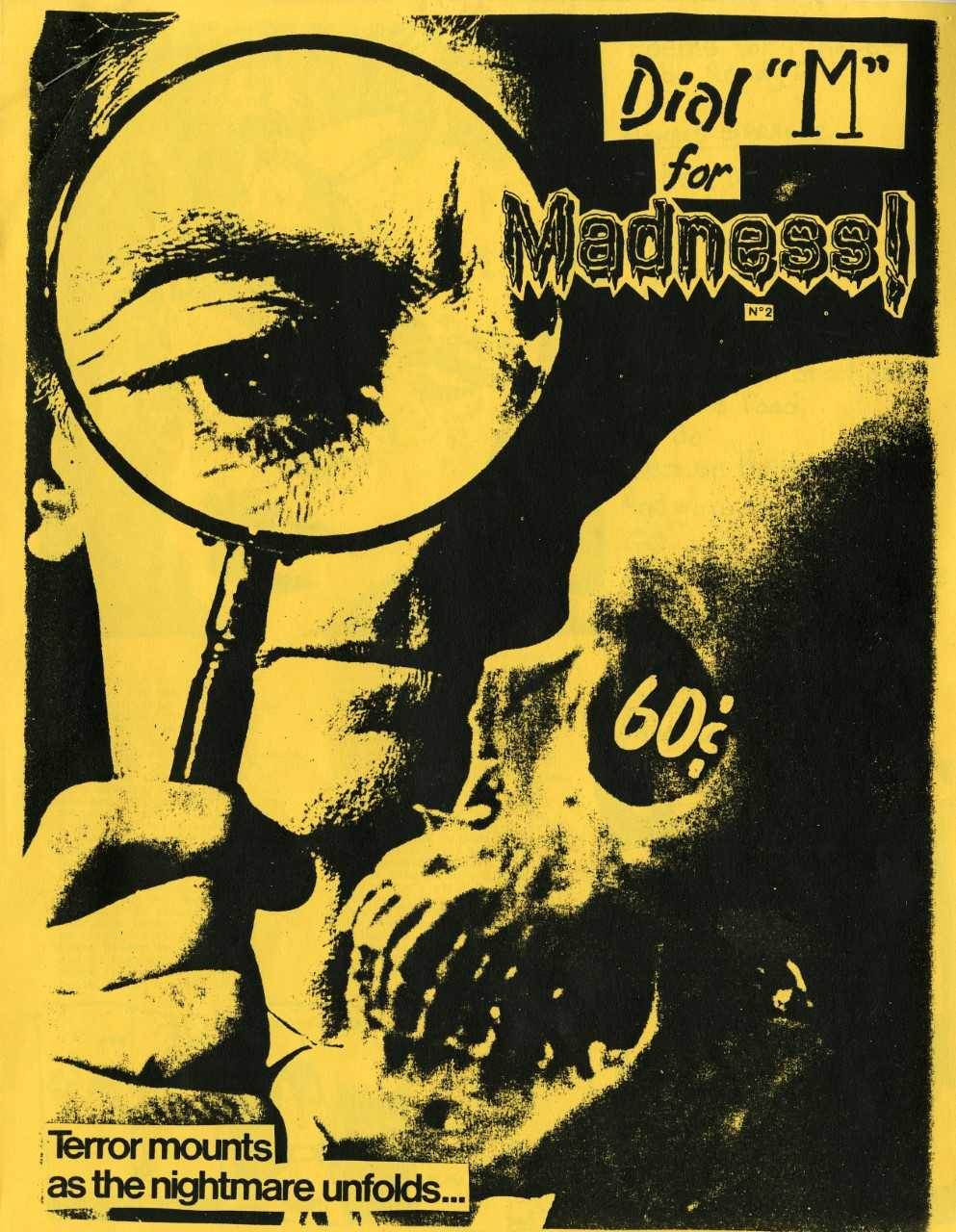 "Front cover of Dial ""M"" for Madness zine yellow cover of a man looking at a skull through a magnifying glass"