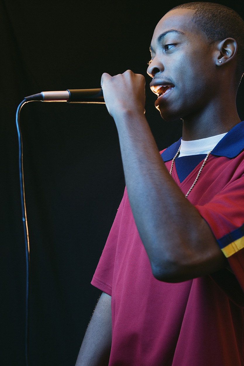 Young man speaking into a microphone