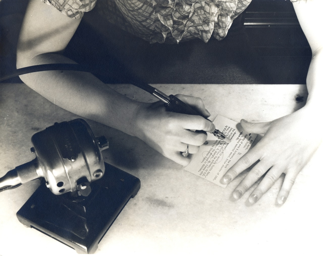 A motor-driven eraser speeds the work in the Catalog Department. Photo taken May 1937.