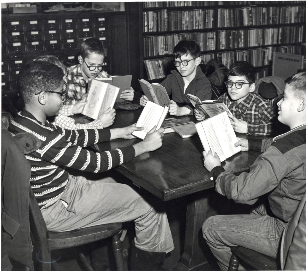 Black and white photograph of a group of boys in our Lewis Carroll Room in 1957