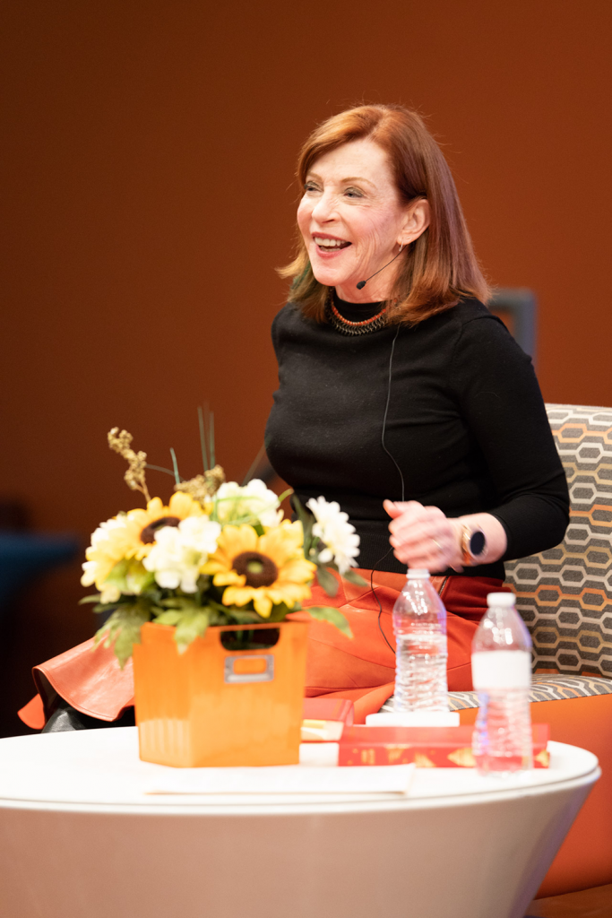 Susan Orlean on stage with flowers