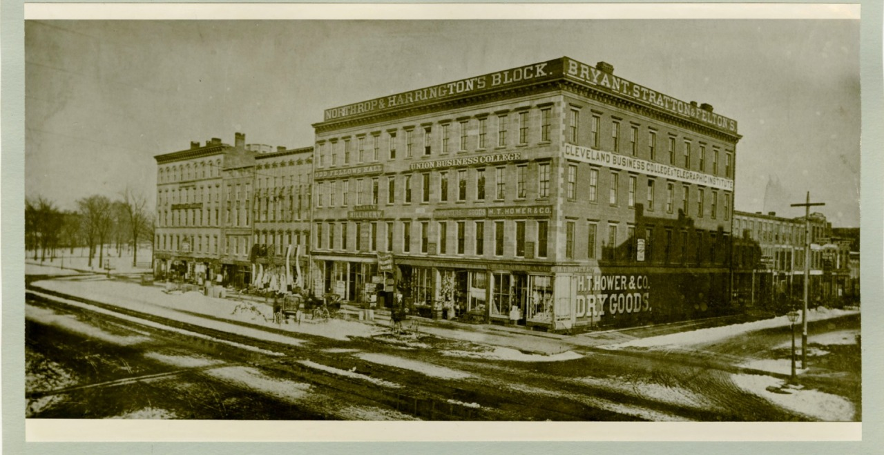 Yellowed black and white photo of 1st Main Library - Northrup and Harrington Block, West 3rd street and Superior Avenue in 1869