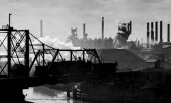 Historical Bridges of Cleveland: Analyzing the Technical and Social Impact on the City (black and white image of a moveable bridge in the upward/open position)
